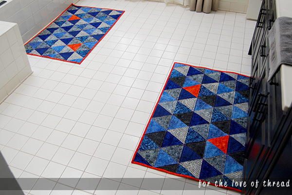two bath mats on a bathroom floor