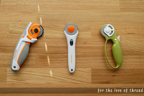 Three Fiskars rotary cutters