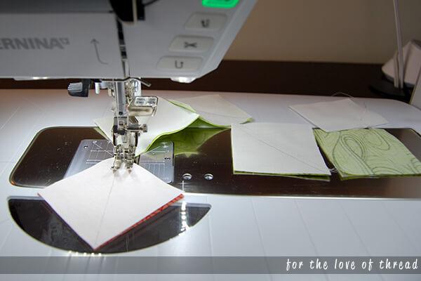fabric squares feeding through a sewing machine