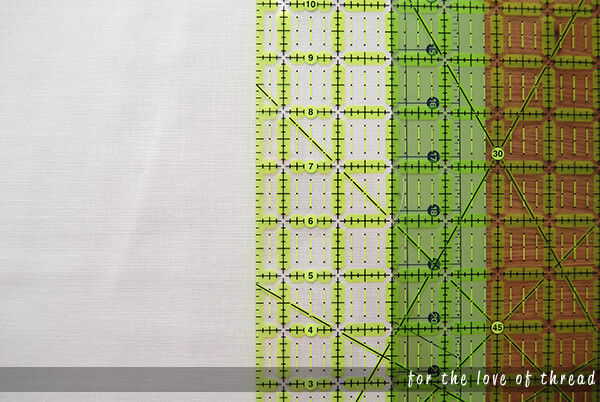 fabric on a cutting mat with a ruler