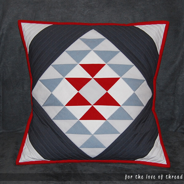Santa Fe pillow on a gray couch