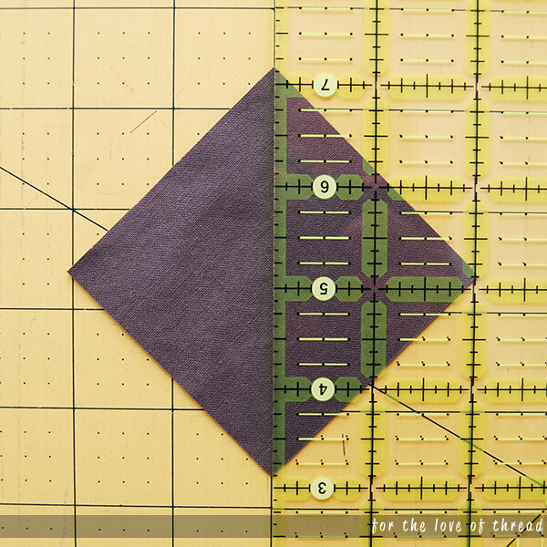 fabric square with quilting ruler