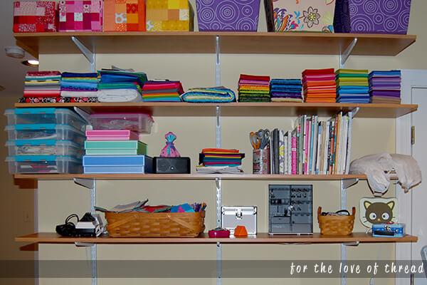 shelves with quilting supplies