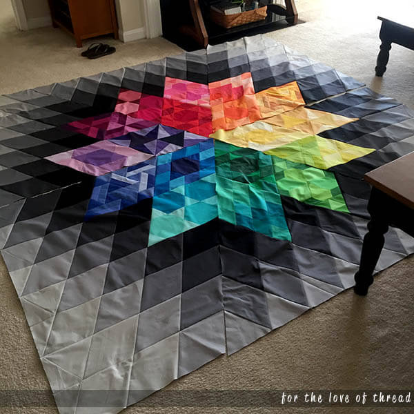 gravity quilt laid out on floor