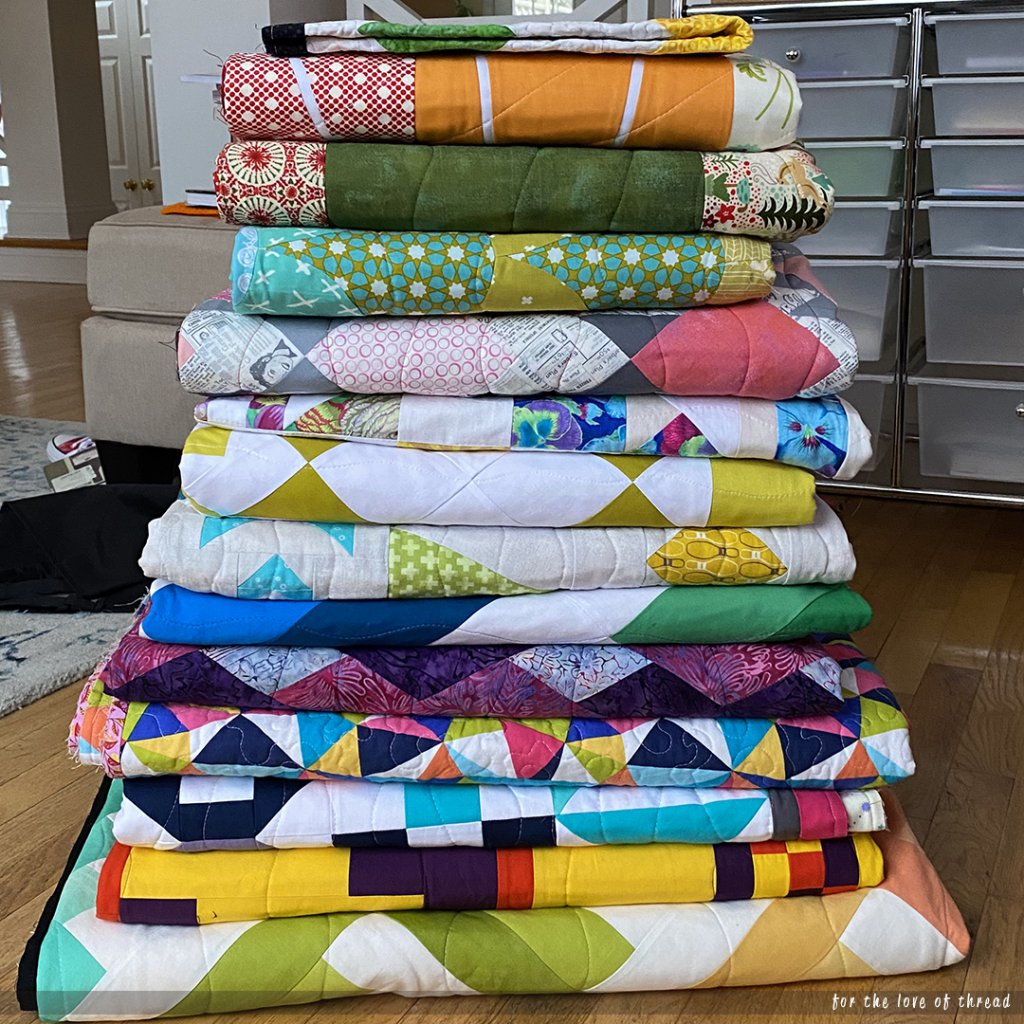 a stack of finished quilts