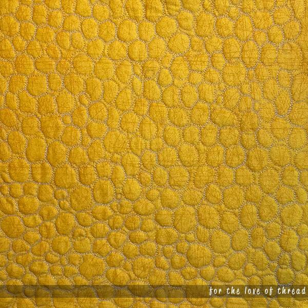 close up of pebbles quilting motif