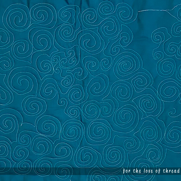 close up of swirls quilting motif