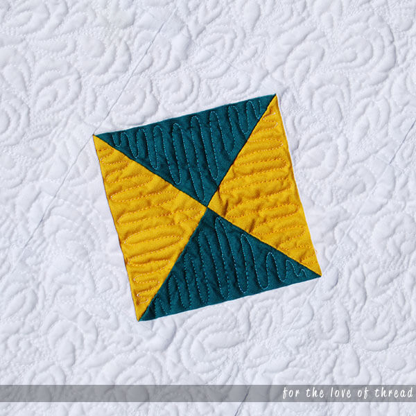 close up of crystalline quilt showing switch back quilting motif on center square