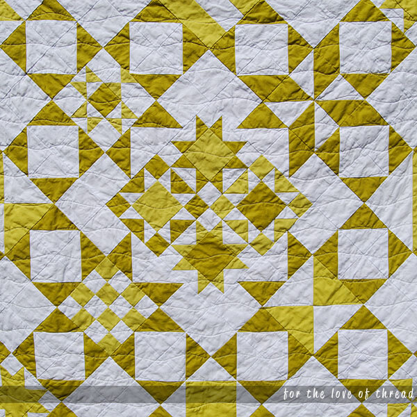 close up of center of Wasabi Pickle quilt to highlight quilting
